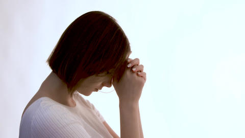Regret. Silhouette of a young woman showing gestures of regret. Straightens her Footage