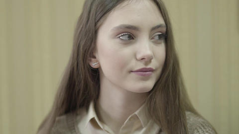 Portrait of a young beautiful smiling girl. Face of pretty young woman close up Live Action