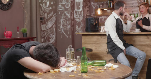 Young bartender tries to wake a drunk customer Live Action