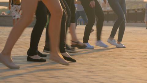 Women dancing at sunset GIF