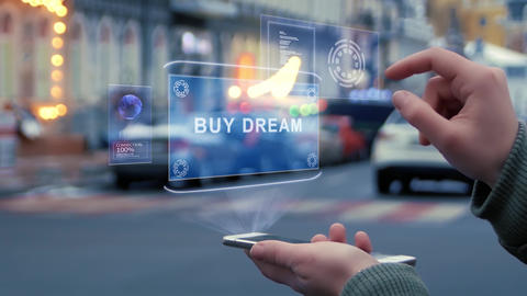 Female hands interact HUD hologram with text Buy dream Footage