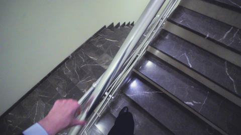 employee goes up stairs to colleagues on landing headcam GIF