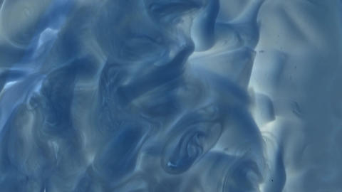 Grey blue stream, transitions of matter between blue and gray like a chemical reaction Footage
