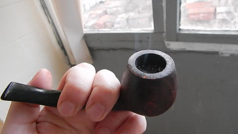 I smoke a pipe on the balcony of the house with real tobacco Live Action