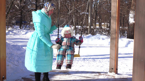 Mum on skates and daughter on sled Footage
