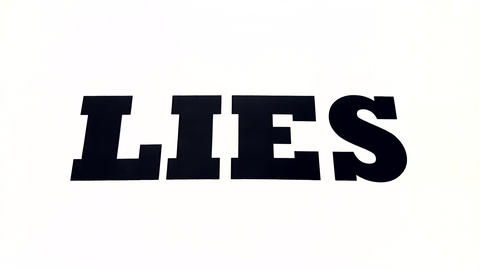 Lies Spelled Out on White Background Fade Out While Zooming In. Abstract Concept of Lying or Telling ビデオ