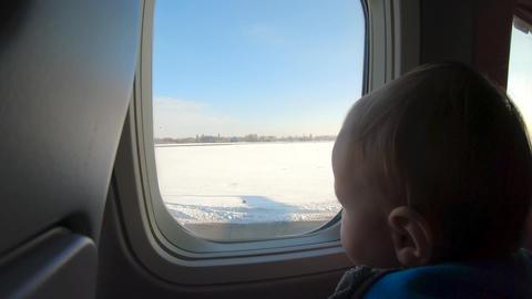 [alt video] Amazing Blonde little boy sits near airplane window and...