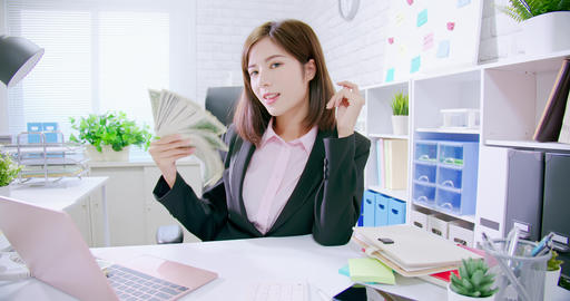 rich business woman with money Live Action