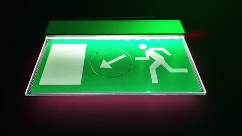 An exit green signage on the ceiling of the building as an emergency exit sign Live Action