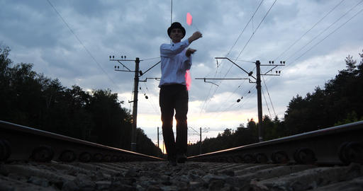 4k - Artist in costume of gentalman makes show on the railway Live Action
