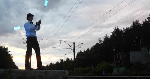 4k - artist at sunset makes danger trick on the railway near movement train Live Action