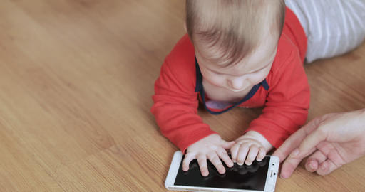 Baby boy playing with a smartphone Live Action