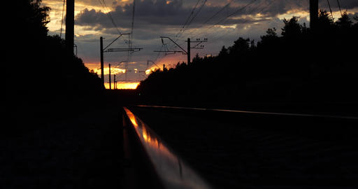 Black and darken perspective of the railway at sunset in slow motion Footage