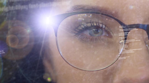 A woman activates a holographic projector in the rim of glasses Footage