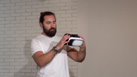 Handsome bearded mature man enjoying using 3d vr glasses for the first time Footage