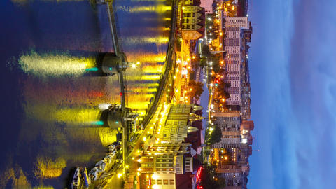 Vertical video. Long transition from night to day. City center of Kaliningrad. View of the Fish Footage