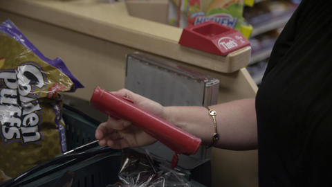 Woman opens wallet to pay for groceries Footage