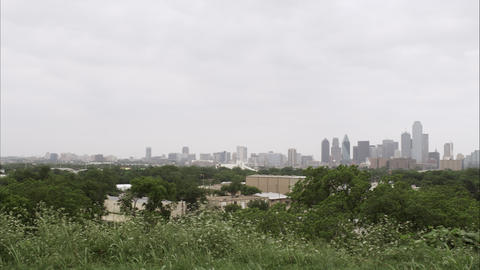Wide distant panning left shot of the Dallas skyline Footage