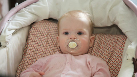 Cute little baby with pacifier Footage