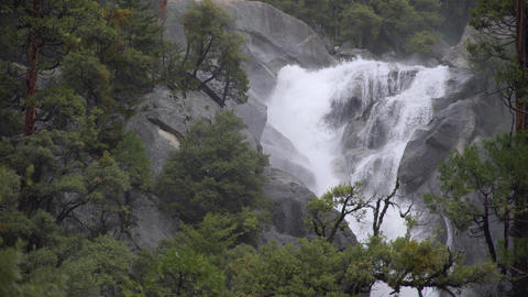 A swollen river crashes on rocks in the Yosemite valley Footage