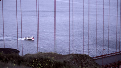 Ferry as seen through the support structure of the Golden Gate Bridge Footage