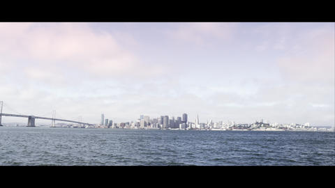 Panning shot of San Francisco and the Golden Gate Bridge as seen from across the Footage