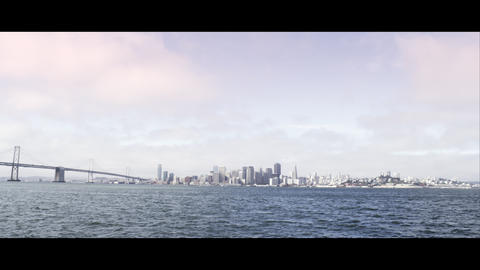 Wide shot of San Francisco and the Golden Gate Bridge as seen from across the ba Footage
