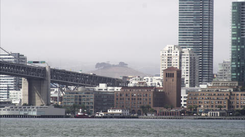 Tight panning shot from the Oakland Bay Brigde to the San Francisco downtown are Footage