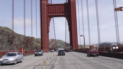 Point of view shot driving in traffic on the Golden Gate Bridge on a bright day Footage