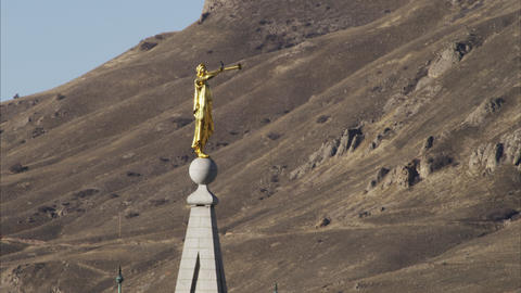 Gold statue of Moroni atop the Salt Lake City Temple Footage