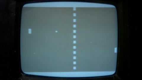 Tight shot of a retro TV screen with Pong being played on the screen Live Action
