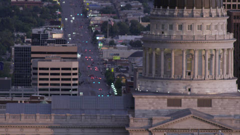 Panning tight shot of the Utah State Capitol building and traffic in the backgro Footage