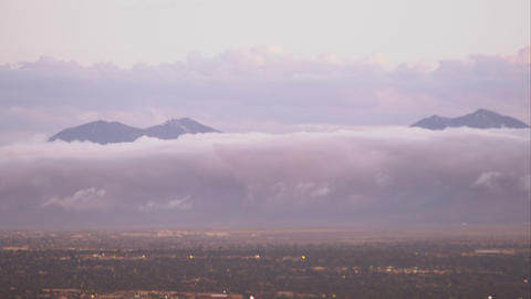Panning shot of the Salt Lake Valley with clouds clinging to the mountains Footage