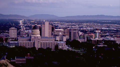 Static shot of Salt Lake City from behind the Utah State Capitol building at dus Footage