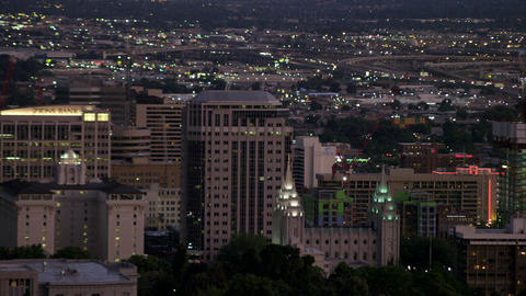 Static shot of Salt Lake City as it lights up at dusk from the hills Footage