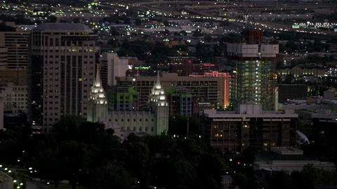 Static shot of Salt Lake City as it lights up at late dusk from the hills Footage