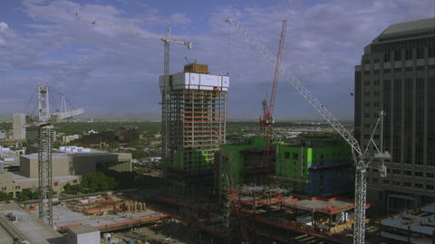 Wide shot of a highrise building under construction in Salt Lake Valley Footage