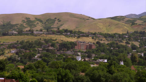 Panning shot from the Utah State Capitol building to the LDS Salt Lake Temple Footage