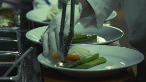 Cook preparing plates for restaurant Footage