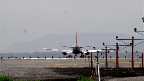 Shot from behind a commercial airliner landing on runway Footage