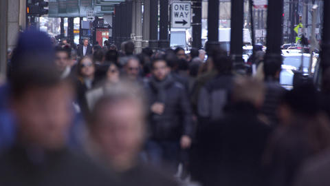 Tight shot of Chicago pedestrians downtown. Faces blurred Footage