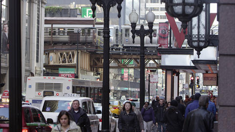 Downtown Chicago street, sidewalk, and L train Footage