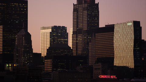 Tight panning shot of the buildings in Chicago at sunset Footage