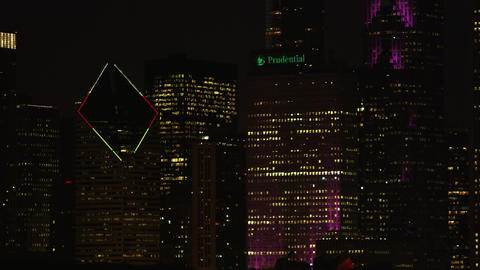 Tight panning shot of Chicago buildings at night time Stock Video Footage