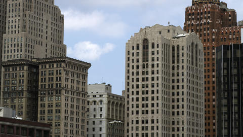 Tight panning shot of the high rise buildings in Detroit Footage