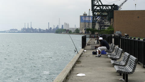 A few men fishing from the wharf in Detroit Footage