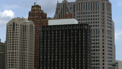 Tilting up shot of several high rise buildings in Detroit Footage