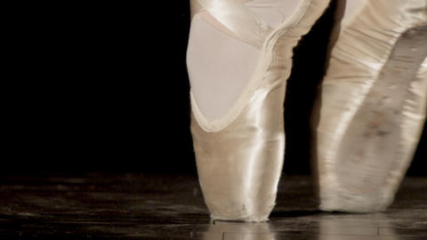 Tight shot of ballerina feet, on point, tip toeing back and forth and out of fra Live Action
