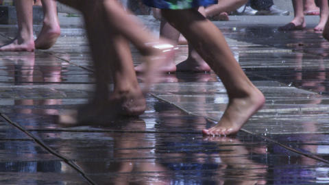 Barefeet running and playing and walking in a splash pad fountain Footage