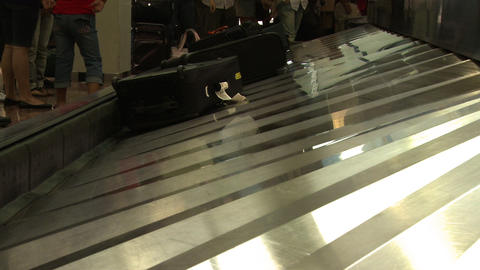 Luggage on the baggage claim conveyor at airport Live Action